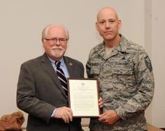 12/9/2013 - U.S. Air Force Master Sgt. David Biddinger, 48th Rescue Squadron pararescueman, receives a Congressional Recognition certificate from Congressman Ron Barber, 2nd District of Arizona, at Davis-Monthan Air Force Base, Ariz., Dec. 9, 2013. Biddinger was one of eight Airmen who were recognized for their swift actions to help victims of a 19-vehicle crash on Oct. 10. (U.S. Air Force photo by Senior Airman Josh Slavin)