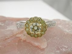 Random Jewels Yellow Diamond Ring, $1,500 | 45 Engagement Rings Inspired By Disney Princesses