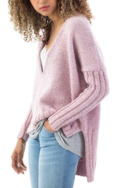 Free Knitting Pattern for Cedar Hill Pullover - This long-sleeved sweater features ribbed sleeves and high low hem with stockinette body and v-neck. 4 pieces. Uses US size 8 and 7 needles and 1215 yards of worsted weight yarn. Sizes S/M (L/XL, 1X/2X). Designed by Michaels and Lion Brand.