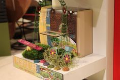This gift-boxed kit includes a mini green vine floral arbor, bicycle, seesaw, and a set of 6 stepping stones. Each kit box includes a card explaining how t