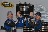 Jimmie and Chad lift the Daytona 500 trophy