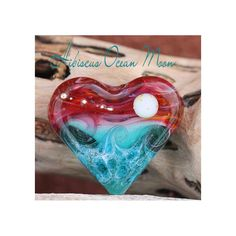 m.o.r.e. new lampwork today =-) Glossy Hibiscus Ocean Moon Heart Bead