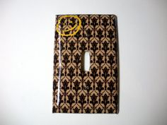 Bring some of 221B to your own home! This handmade decoupaged switch plate cover features the famous wallpaper and yellow smiley face from Sherlock