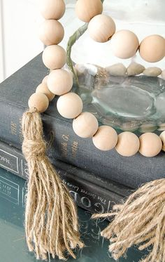 An easy tutorial for creating a $5.00 wood bead garland with tassels! www.littlehouseoffour.com