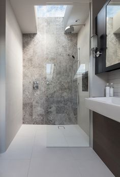 peek architecture + design - walk in shower, stone feature wall, silver emperador tiles, roof lights, bathroom joinery Skylight Bathroom, Bathroom Windows, Bathroom Feature Wall Tile, Bad Inspiration, Bathroom Inspiration, Grey Bathrooms, Modern Bathroom, Grey Marble Bathroom, Stone Feature Wall