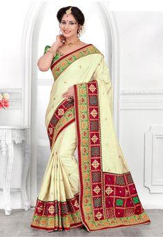 https://www.gravity-fashion.com/cream-designer-wear-raw-silk-bandhej-print-border-saree-with-blouse-e17259.html