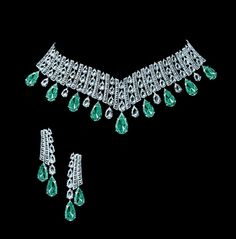 Tabbah | Collections Designs. Don't care much for the earrings, but the necklace looks like it has potential.