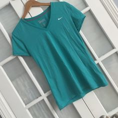 S teal Nike dri-fit shirt! Worn once. Really pretty color! Nike Tops Tees - Short Sleeve