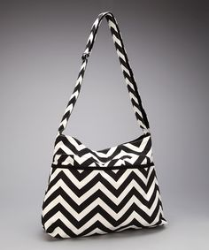 Take a look at this Black & White Chevron Shoulder Bag by Picki Nicki on #zulily today! $33.99, originally 70.00  Product Description:   For instant style, sling this chevron bag over the shoulder and tote around a trendy new look. Fashionistas on the hunt for a functional fix will love the bold graphic print and secure zip-closure design.    •16'' W x 12.5'' H x 4'' D •Canvas •Imported