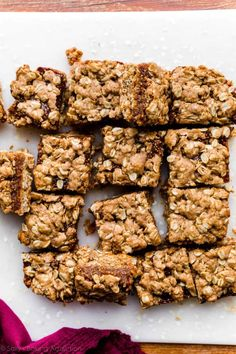 These soft-baked homemade fig bars come together with nutritious whole oats, dried figs, whole wheat flour, maple syrup, and brown sugar. Nutmeg, cinnamon, and a little orange juice add delicious flavor to these wholesome snack bars! A Food, Food And Drink, Fig Bars, Homemade Oatmeal, Sallys Baking Addiction, Dried Figs, Orange Juice, Maple Syrup, Food Processor Recipes