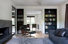 All about the built-in/flush shelving. Villa 't gooi Project. Designed by Remy Meijers Interieur Architectuur. (Click on photo for larger image.) Photo found here: http://www.remymeijers.nl/portfolio/interieurs/project-titel/