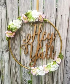 Hula Hoop Wreath. Different flowers and this would balance my Merry Christmas sign perfectly.