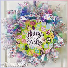 Happy Easter Wreath Wreath is made from rolled pastel colored mesh. Has 2 Easter ribbons and glitter eggs around. Happy Easter sign in the center with purple foil lettering. Great way to decorate your door at home, work, office, classroom, or gift it to someone. 25inch Approx Follow Us On Social Media: Facebook https://m.facebook.com/YaaasDecor/ Instagram: @Yaaasdecor