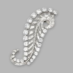 PLATINUM AND DIAMOND CLIP-BROOCH, CIRCA 1950. Set with round and single-cut diamonds weighing approximately 8.85 carats, and baguette diamonds weighing approximately 3.75 carats, with pendant hook.