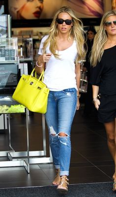 Distressed jeans for a summer night with colorful large bag! Style baby