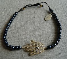 Gold Hamsa Hand Charm with navy beads by NokoDesigns