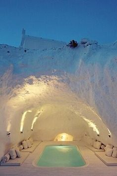 A hot tub...IN A CAVE in Santorini, Greece. I wish I was there right now!
