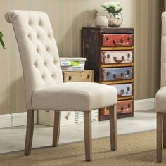 Button tufted for a tailored look, theBersum Solid Wood Button Tufted Side Chairupgrades your kitchen or dining room. This set includes two parson's style dining chairs. The wood frames are armless design.