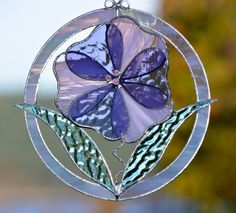 RESERVED LISTING for Nancy ~ Thank You!  Stained Glass Flower Suncatcher Window Home Decor  I have placed a pink and lilac 3D flower in a white iridescent frame. Two pastel green leaves and Swarovski crystal flower stamens accent this lovely sun catcher.  This would also look great on a wall, for anyone short on window space.  This measures 6 1/2 across and 7 tall.  This would make an great and original gift, as this is my own original design. I can make these in virtually any colour as…