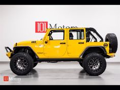 MODIFIED 4 DOOR JEEP JK WITH CUSTOMIZED RIMS WITH HOOD VENTS