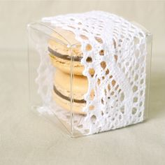 macarons and lace - dessert idea: wrap glass square candle holders from Dollar Tree in lace; put one at each place setting