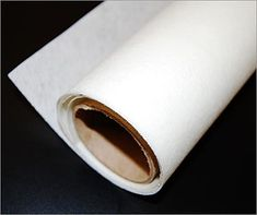 Synskin: translucent, smooth textured vinyl coated fiberglass that looks like rice paper. Ideal for: room dividers, lamp shades etc