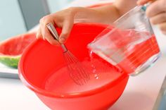 Then add 4 cups of vodka, and whisk just to mix everything together. | Here's How To Make XXL Watermelon Jell-O Shots
