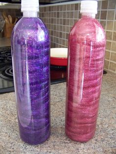 Fill each bottle with about 3/4 full with hot water, an entire bottle of glitter glue and a small tube of ultra fine glitter.  Play with the mixture for setting time - more clear gel glue to make it go slower or more water to make it settle faster.  Super glue the lid on.
