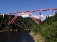 Garabit Viaduct (Viaduc de Garabit in French) is a railway arch bridge spanning the River Truyère near Ruynes-en-Margeride (Fr), Cantal, France, in the mountainous Massif Central region. The bridge was constructed between 1882 and 1884 by Gustave Eiffel, with structural engineering by Maurice Koechlin and was opened in 1885. It is 565 m (1,854 ft) in length and has a principal arch of 165 m (541 ft) span.