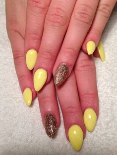 Yellow pastel almond nails work a golden glitter - no filter and pretty awesome and very Easter-y :)