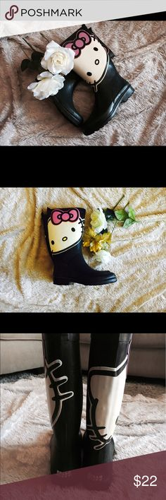 Hello Kitty Sanrio Rain Boot size 7 💗 Pre-Loved Hello Kitty Rain Boot. Very Rare to find. It's in a size 7. The hello kitty has some defects. The color is a bit off. Other than that, it's in great condition. Looking for an owner to Re-Love it! 💕 Sanrio Shoes Winter & Rain Boots