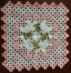 Rose Bud Hardanger Doily Handcrafted and Intricate! Approx 8 inch sqare CAD $44.44. Hardanger doily stitched with pearl color 224, with matching roses cross stitched with 224 Rose color floss. Approximately 8 inches square, handcrafted in a smoke-free home. Back is almost as pretty as the front - see pictures! 162503401596