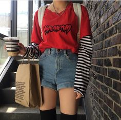 Like the horizontal stripes on the sleeves, the high-waisted shorts, and the specific shade of somewhat dark red/pink that goes well with denim blue.  @radvxbess