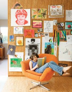 Living Room, Chair, and Light Hardwood Floor The pair's art covers a cork wall where Eva Luna reads in a vintage Danish lounge chair. Photo 4 of 13 in A Fresh Dose of Color Livens Up This Midcentury Los Angeles Home Cork Wall, Kids Artwork, Framed Artwork, Dose Of Colors, Blog Deco, Hanging Art, Kid Spaces, Art For Kids, Kid Art