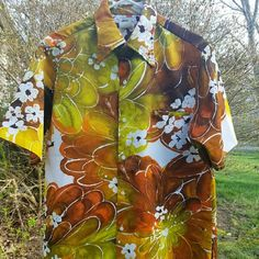 """Vintage 70s Tori Richard Honolulu Hawaiian Shirt It's the season of tropical prints!  Preowned Vintage 1970s Tori Richard Honolulu Hawaiian Shirt Polyester Floral Print Large Mens  Polyester in earthy color scheme Button front Front welt chest pocket Straight hem  Measurements approx:   Back length measures approx 29""""  Shoulder to shoulder across the back measures approx 18 1/2""""  Underarm to underarm across the back measures approx 23 1/2"""" Tori richards Tops Button Down Shirts"""