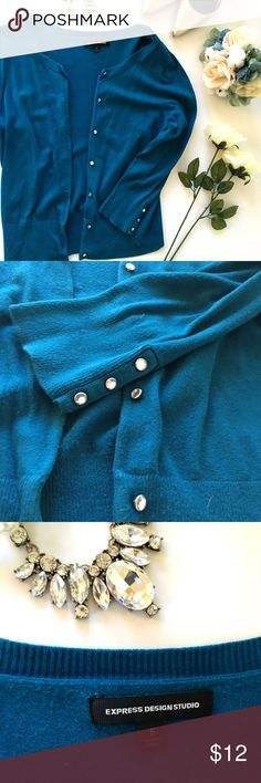 Express Cardigan with Rhinestone Buttons This gorgeous teal blue cardigan from Express has rhinestone buttons to add a hint of glam to your work wardrobe! Super soft knit fabric and 3/4 length sleeves. In very good used condition. Hope you love your new cardigan! Express Sweaters Cardigans