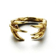 Dinosaur claw ring by Verameat -- available in brass and sterling silver