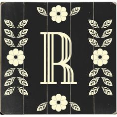 Add vintaged style to your entryway gallery with this monogrammed wall decor, featuring a floral border.  Product: Wall decor