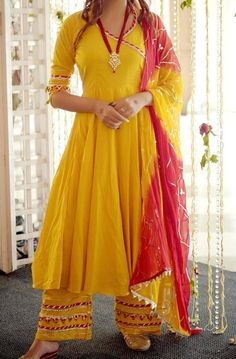 Shine bright at every celebration in our Royal Yellow Suit with intricate Gotapatti Anarkali Kurta paired with Yellow Palazzo in Gotapatti work detailing along with Dupatta. Indian Fashion Dresses, Dress Indian Style, Indian Designer Outfits, Indian Outfits, Ethnic Fashion, Fashion Black, Pakistani Dresses, Girl Fashion, Kurta Designs