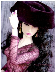 Love the soft yet seductive look of her hair and skin, with the purple, and the delicacy of the shirt contrasting with the hat.