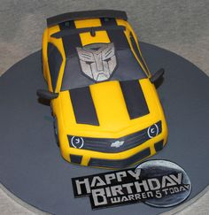 A Transformers Bumblebee car cake for a customer's little man's 5th Birthday complete with edible handpainted transformers sign and a Happy birthday sign painted in the style of the transformers Dark of the Moon sign! Young Warren absolutely loved...