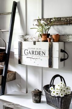 Garden sign crate entry table on a wall.