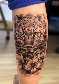 Leopard and flowers tattoo. Not impressed by most tattoos, but I like this.