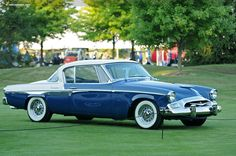 1955 Studebaker = This car was marketed as an American Sports Car with European Styling. This would have been a 2+2 hardtop coupe. It was Low Slung, Sleek, Fast, Stylish, Comfortable, and Well Made... it was also Expensive, costing nearly double that of a standard Ford or Chevy.