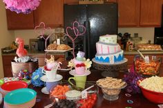 "Ella in One-derland (Alice in Wonderland) theme food served at my daughter's party.  I found cute tea cups and saucers to stack at a second hand store.  Small signs are around the food saying, ""Eat Me."""