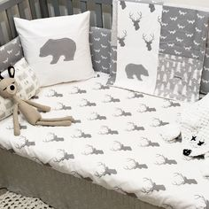 Monochrome gray and white woodland nursery crib bedding set with bear, deer, fox, trees, and herringbone by SleepingLakeDesigns on Etsy.