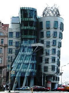 "Dancing House, Prague, Czech Republic Touch of 1990s whimsy, Prague's ""Dancing House,"" on Resslova Street, designed by Frank Gehry and Vlado Milunic, represents an upstanding Fred Astaire with a flare-skirted Ginger Rogers"