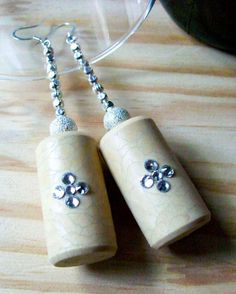 In The Garden :: Handmade synthetic wine cork dangle earrings featuring clear Swarovski Elements rhinestones, silver plated stardust rounds and silver etched spacer beads. www.grapevarietyjewelry.etsy.com
