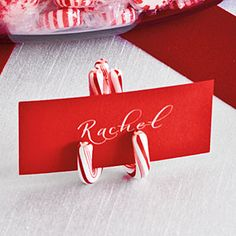 Most Pinned Christmas Decorating Ideas | Candy Cane Place Card Holder | SouthernLiving.com