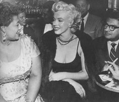 Marilyn with Ella Fitzgerald and Hollywood columnist Sidney Skolsky at the Mocambo Club, November 19th 1954.